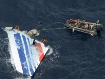 File photo of Brazilian Navy sailors picking a piece of debris from Air France flight AF447 out of the Atlantic Ocean
