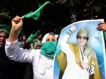 Libyans loyal to leader Muammar Gaddafi demonstrate during a prot