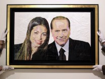 A painting called ' Silvio & Ruby' made with plastic bags and scotch tape is displayed at the Edward Cutler gallery in Milan