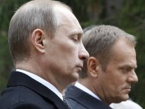 Russia's Prime Minister Putin and his Polish counterpart Tusk take part in a wreath-laying ceremony at a memorial complex at Katyn