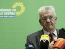 Kretschmann state leader of the Green Party in Baden-Wuerttemberg attends a news conference in Stuttgart