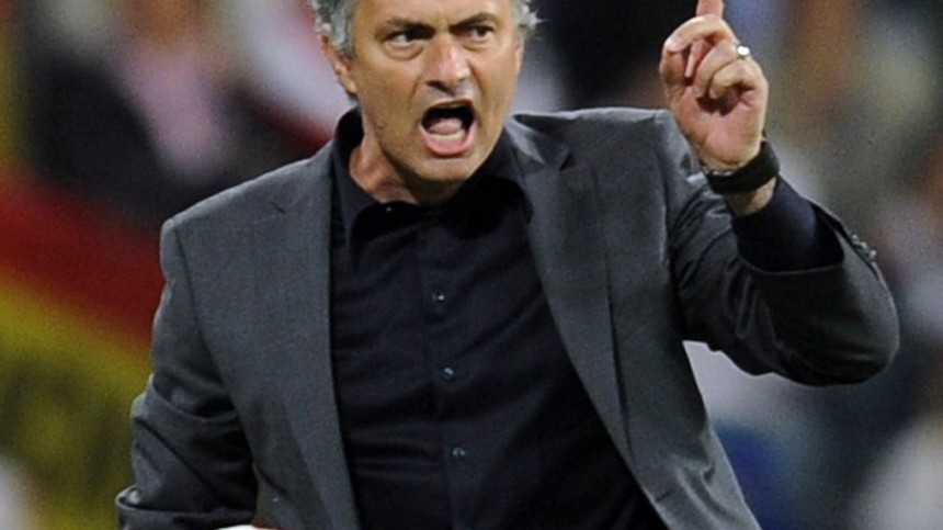 Real Madrid's coach Mourinho reacts during their Spanish first division soccer match against Barcelona in Madrid