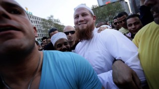 Islamic cleric Pierre Vogel is escorted by his bodyguards as he makes his way through thousands of his supporters after a pro-Islamic demonstration in downtown Frankfurt