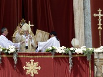 Pope Benedict XVI holds his cross as he gives the 'Urbi et Orbi' blessing in Saint Peter's Square in Vatican