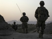 U.S. Army soldiers walk back to their base after a patrol in Arghandab Valley, north of Kandahar