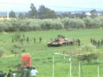 Still image taken from amateur video footage shows tanks and soldiers purportedly near Deraa