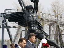 Dmitry Medvedev, Viktor Yanukovich and Kirill attend a memorial ceremony at the nuclear power plant in Chernobyl