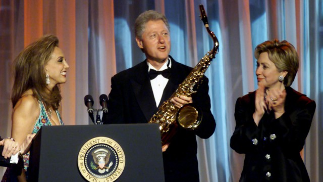 FILE PHOTO OF DENISE RICH PRESENTS BILL CLINTON WITH SAXAPHONE AT BENEFIT GALA IN NEW YORK