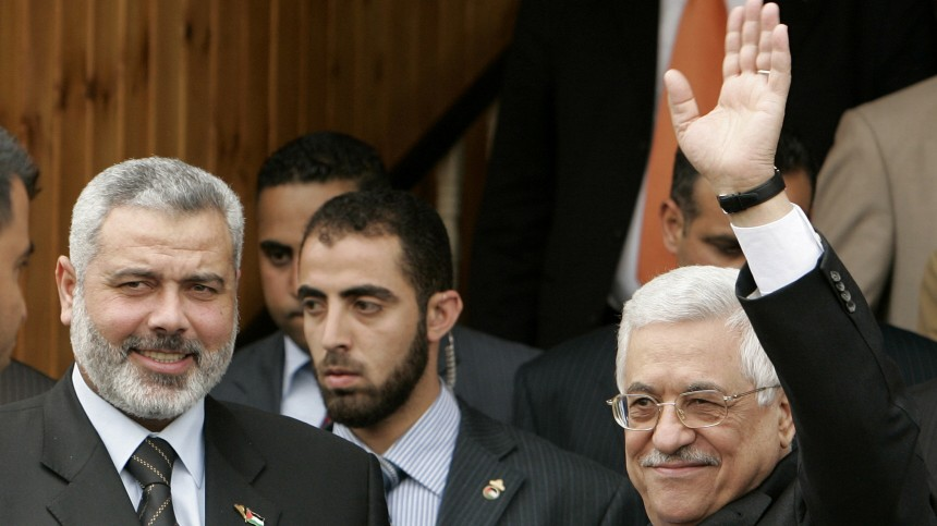 File photo of Palestinian President Abbas waving after his meeting with Prime Minister Ismail Haniyeh in Gaza