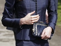 Kate Middleton, the fiancee of Britain's Prince William carries a hand bag during their visit to Witton Country Park in Darwen, northern England
