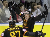 Germany's Reimer celebrates with team mate Gogulla after scoring against Russia during IIHF World Championship match in Bratislava