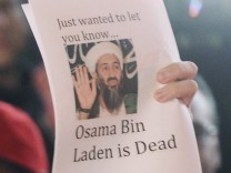 People celebrate after Al Qaeda leader bin Laden was killed in Pakistan, during a spontaneous celebration in New York