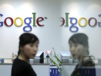 An employee walks at Google Inc's office in Seoul