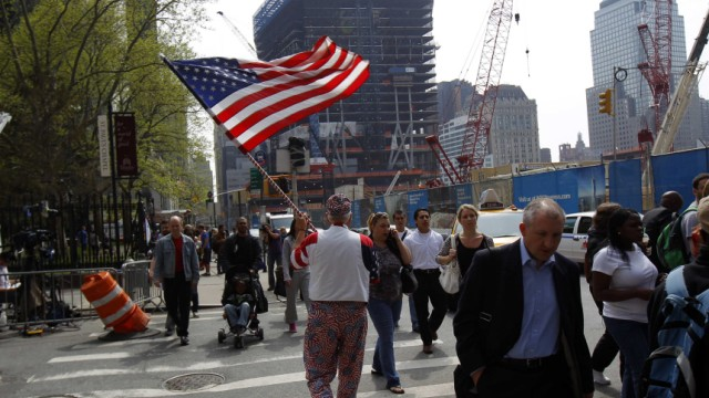 Man carries American flag outside World Trade Center site in New York after killing of Osama Bin Laden