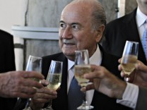 FIFA President Sepp Blatter drinks a toast in Luque