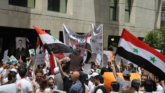 Syrians protest in front of the French embassy in Damascus