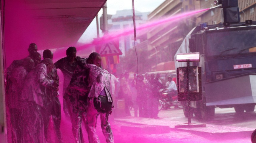 Police spray Ugandan opposition party leaders with coloured water during demonstrations in the capital Kampala