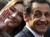 File photo of France's President Nicolas Sarkozy and first lady Carla Bruni-Sarkozy smiling in Strasbourg
