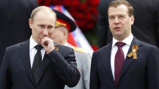 Russian President Medvedev and PM Putin attend a wreath laying ceremony at the Tomb of Unknown Soldier on the eve of Victory Day celebrations in Moscow
