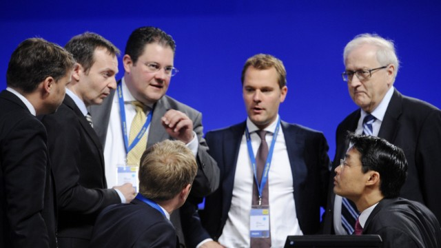 New leader of the liberal FDP party and German Economy Minister Roesler listens to party fellows at the FDP party convention in Rostock
