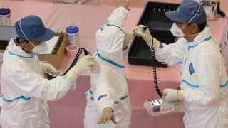 Villagers of radiation contaminated area make a brief visit to th