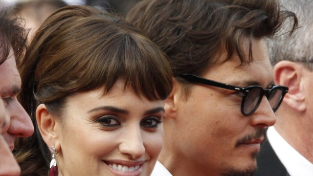 Cast members Cruz and Depp pose at the 64th Cannes Film Festival