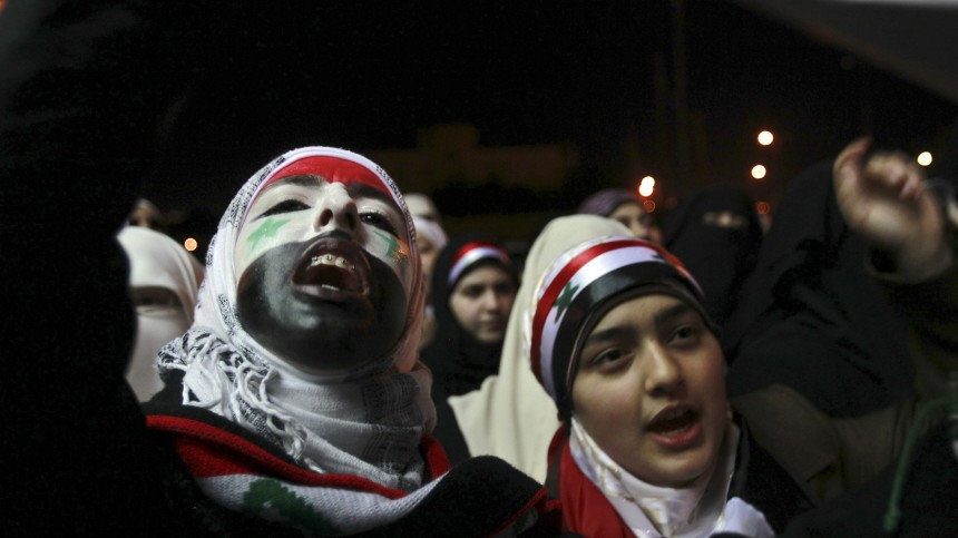 Syrian women living in Jordan during a demonstration in front of the Syrian embassy in Amman