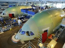 File photo of employees working in the fuselage section of the A380 Airbus in Montoir-de-Bretagne