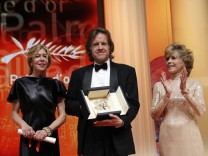 Producer Pohlad reacts with actress Fonda and producer Dede Gardner after receiving the Palme d'Or award for the film The Tree of Life during the closing ceremony of the 64th Cannes Film Festival