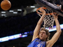 Dallas Mavericks Dirk Nowitzki of Germany misses a dunk against Oklahoma City Thunder during Game 4 of the NBA Western Conference Final basketball playoff in Oklahoma City