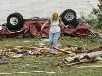 A woman participates in the search for missing children after a tornado ripped through the Falcon Lake area of Piedmont