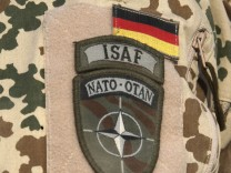 The patches of a German Bundeswehr army paratroop sniper of the Task Force Kunduz including his nick name is pictured during a drill in Kunduz