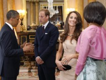 U.S. President Barack Obama and first lady Michelle Obama talk to Britain's Prince William and Catherine, Duchess of Cambridge at Buckingham Palace, in London