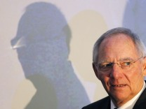 German Finance Minister Schaeuble arrives to attend the Brussels Economic Forum