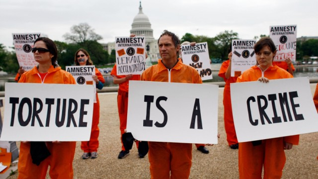 Human Rights Activists Rally For Investigation Into Bush Administration