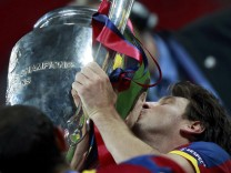 Barcelona's Messi kisses the trophy after the Champions League final soccer match against Manchester United at Wembley Stadium in London
