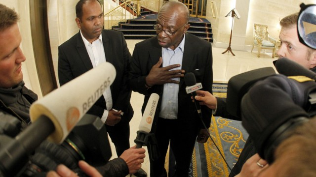 Suspended FIFA executive member Warner talks to journalists at the lobby of a hotel in Zurich
