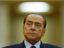 Italy's Prime Minister Berlusconi attends a joint news conference with Romania's Prime Minister Boc at Victoria Palace in Bucharest
