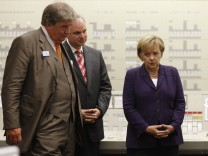 German Chancellor Merkel listens to CEO Grossmann of RWE and CEO Teyssen of E.ON in control centre at nuclear power plant in Lingen