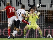 Germany's Gomez scores a goal past Austria's Royer and Gratzei during their Euro 2012 Group A qualifying soccer match in Vienna