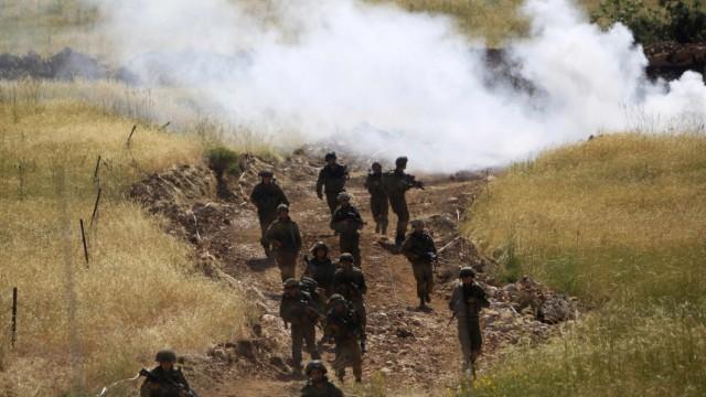 Israeli soldiers patrol along the Israeli-Syrian border near Majdal Shams in the Golan Heights