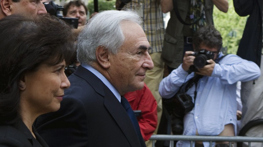 Former IMF chief Dominique Strauss-Kahn departs the New York State Criminal Courthouse with his wife Anne Sinclair after entering a plea of not guilty during a hearing in New York