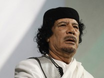 File photo shows Libyan leader Gaddafi speaking in Rome