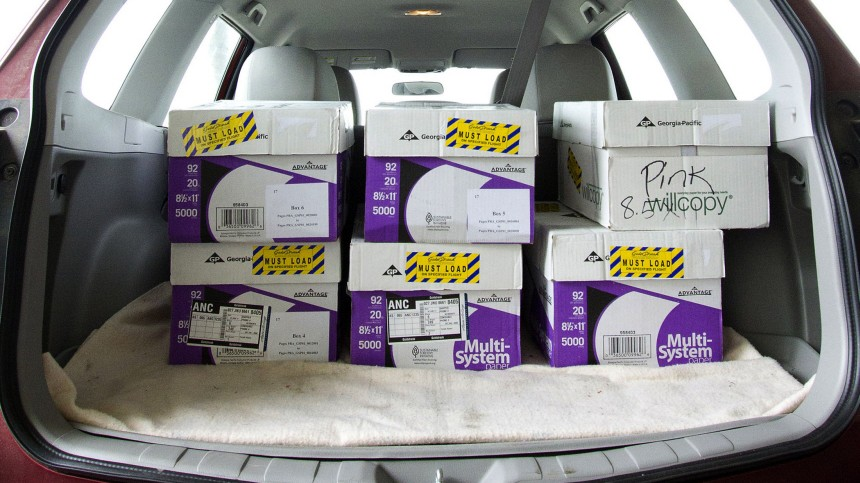 Boxes containing some of former Governor Sarah Palin's emails are seen in a reporter's vehicle in Anchorage