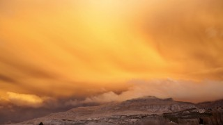 A view is seen of a cloud of ash from Chile's Puyehue-Cordon Caulle volcano chain near sunset at the mountain resort San Martin de Los Andes