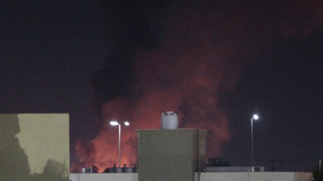 Smoke and fire are seen after coalition air strikes, in Tripoli