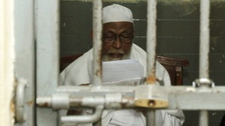 Indonesian militant cleric Abu Bakar Bashir waits inside a cell before his trial at South Jakarta court