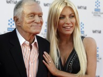 File photo of Hugh Hefner and his fiancee at an opening night gala in Hollywood