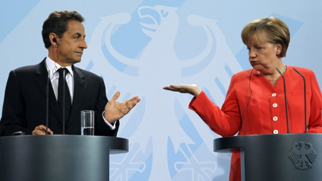 French President Sarkozy and German Chancellor Merkel address a news conference at the Chancellery in Berlin
