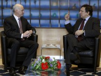 European Commission President Barroso talks with Greece's Prime Minister Papandreou during a meeting in Brussels